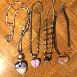 4 heart necklaces of various lengths.